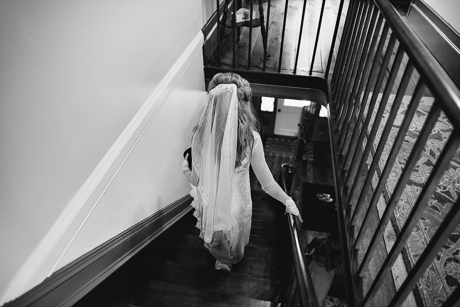 Best-Moody-Documentary-Wedding-Photography-Photojournalism-Vintage-Small-Town-Chapel-Wedding-Toronto-Ontario_Bride-exit-staircase-BW.jpg