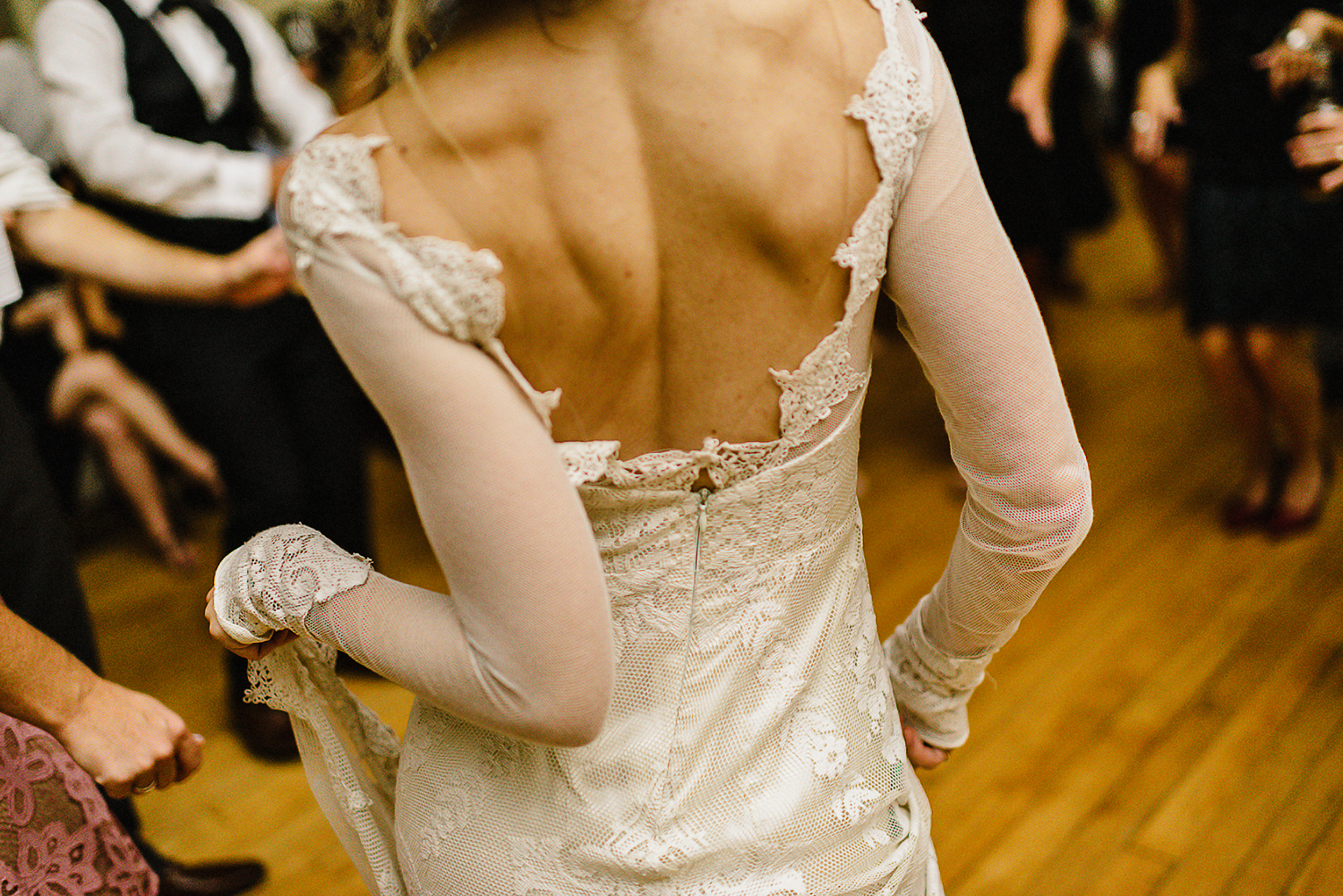 Best-Moody-Documentary-Wedding-Photography-Photojournalism-Vintage-Small-Town-Chapel-Wedding-Toronto-Ontario_Reception-Dance-Party-Bride-dancing-dress-details.jpg