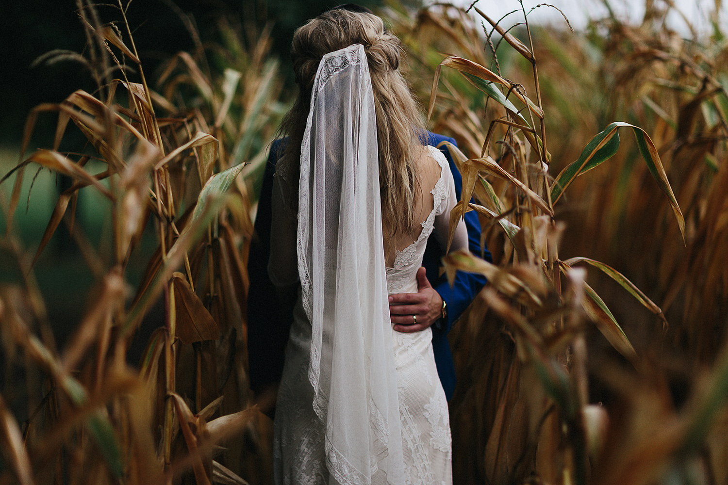 Best-Moody-Documentary-Wedding-Photography-Photojournalism-Vintage-Small-Town-Chapel-Wedding-Toronto-Ontario_Bridal-Portraits-Bride-and-groom-vintage-candid-portrait-in-cornfield.jpg