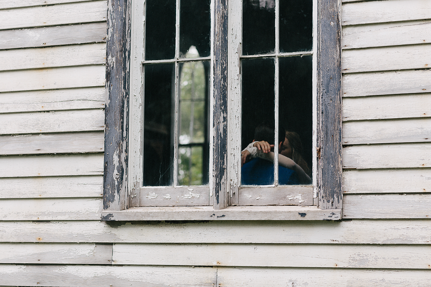 Best-Moody-Documentary-Wedding-Photography-Photojournalism-Vintage-Small-Town-Chapel-Wedding-Toronto-Ontario_Bridal-Portraits-Bride-and-groom-quiet-moment-in-chapel-candid-window.jpg