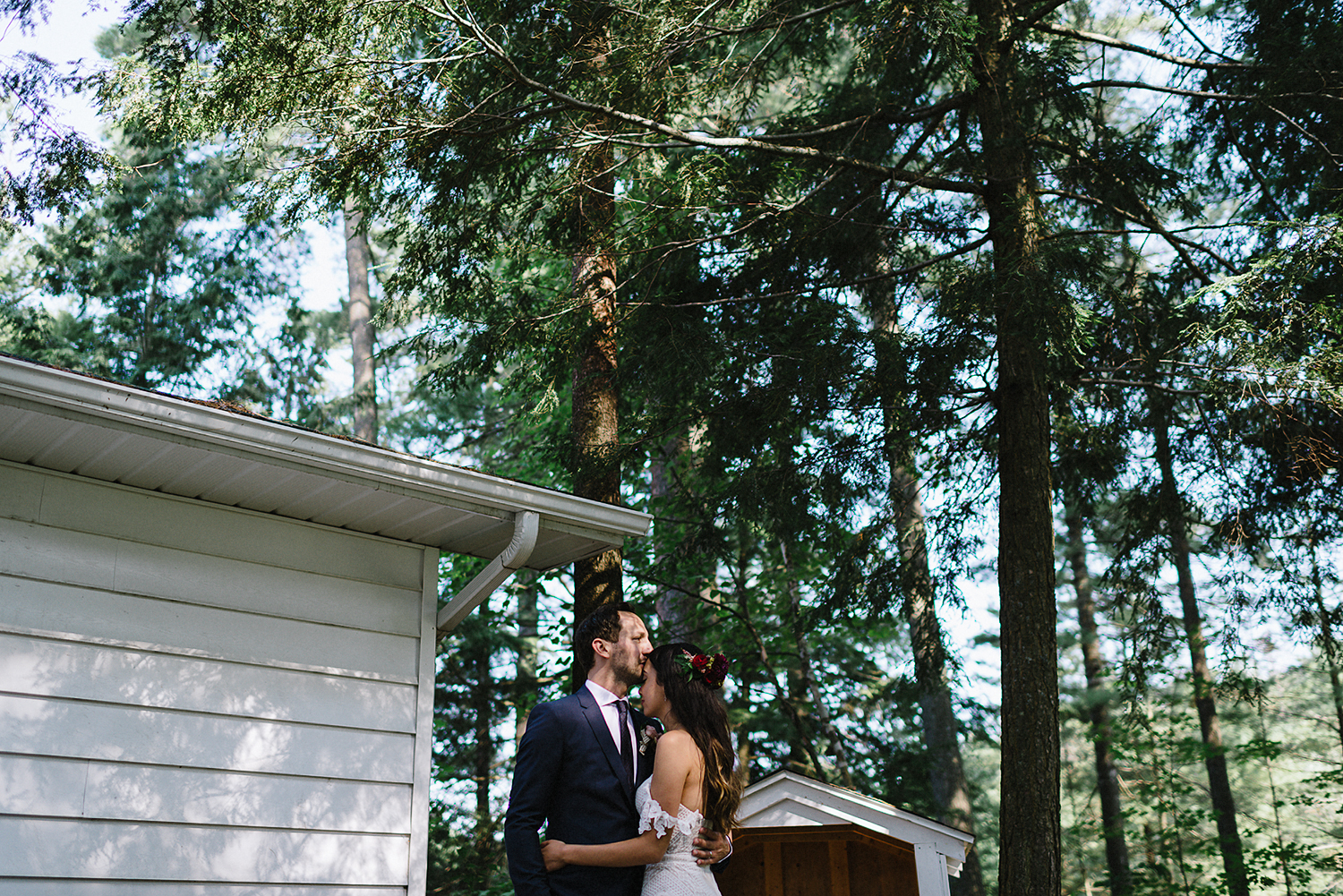 Muskoka-Cottage-Wedding-Photography-Photographer_Photojournalistic-Documentary-Wedding-Photography_Vintage-Bride-Lovers-Land-Dress_Rue-Des-Seins_Forest-Ceremony-Bride-and-Groom-Intimate-Lakeside-.jpg