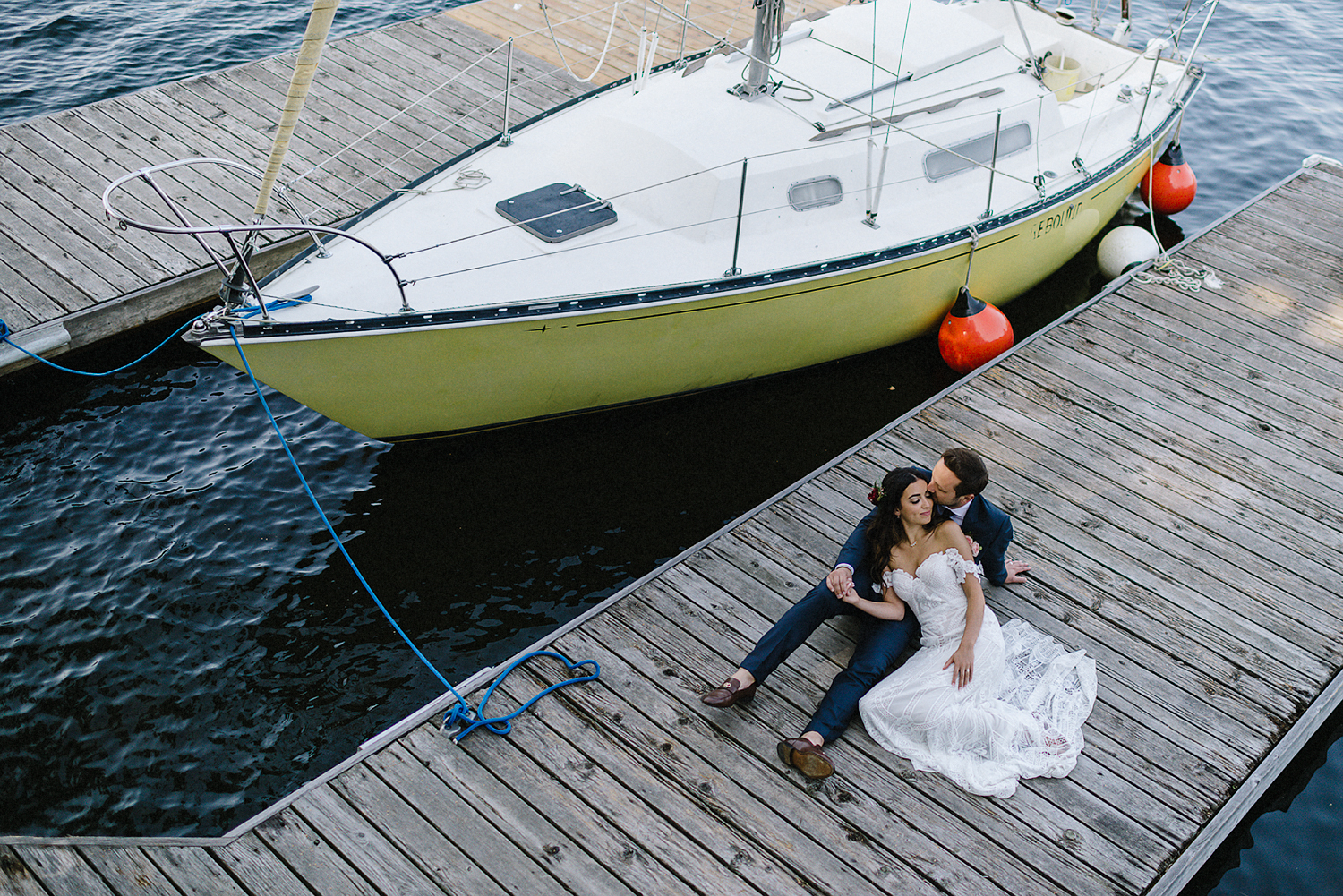 Muskoka-Cottage-Wedding-Photography-Photographer_Photojournalistic-Documentary-Wedding-Photography_Vintage-Bride-Lovers-Land-Dress_Rue-Des-Seins_Forest-Ceremony-Bride-and-Groom-Intimate-on-Sailboat.jpg