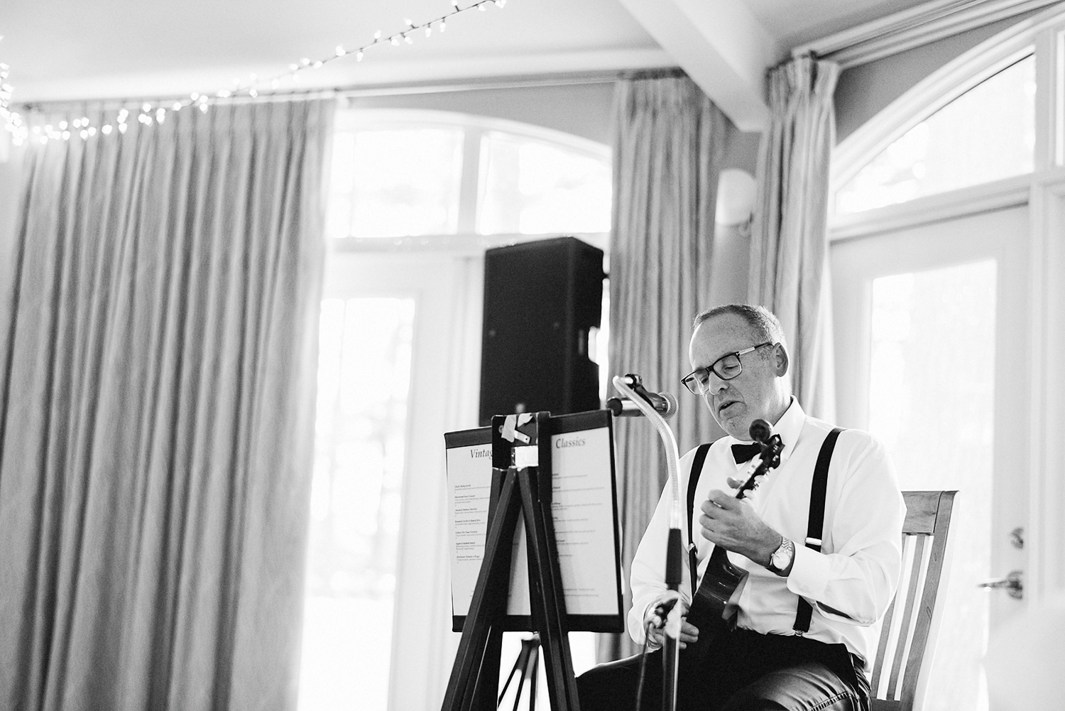 Muskoka-Cottage-Wedding-Photography-Photographer_Photojournalistic-Documentary-Wedding-Photography_Vintage-Bride-Lovers-Land-Dress_Nature_Film_Sherwood-Inn-Reception-Venue-Dad-playing-Ukelele.jpg
