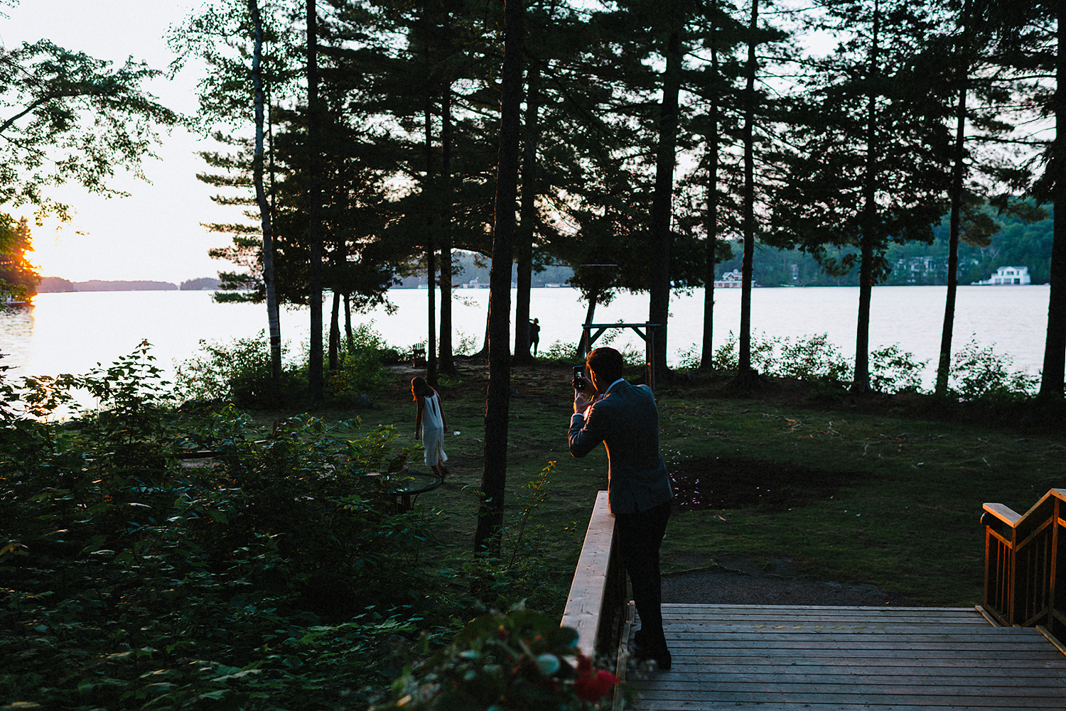 Muskoka-Cottage-Wedding-Photography-Photographer_Photojournalistic-Documentary-Wedding-Photography_Lakeside-Ceremony-Sunset-Light-guests.jpg