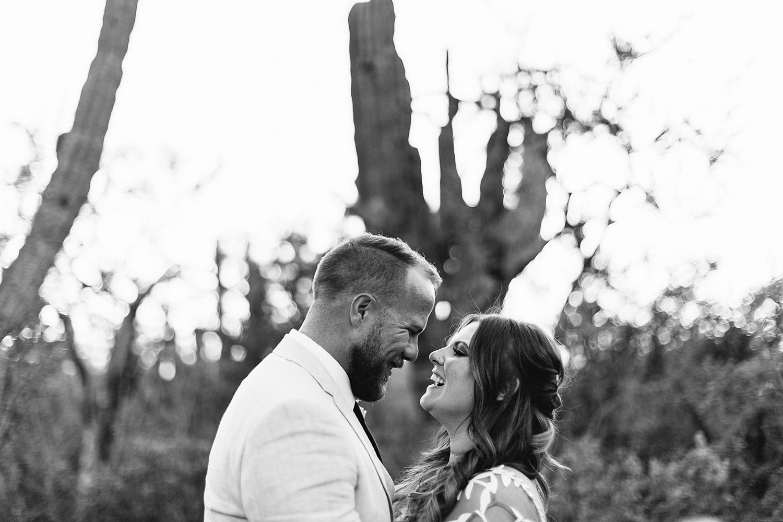 cabo-san-lucas-junebug-weddings-green-wedding-shoes-toronto-wedding-photographer-3b-photography-ventanas-private-club-mexico-bride-and-groom-portraits-laughing-candid.jpg