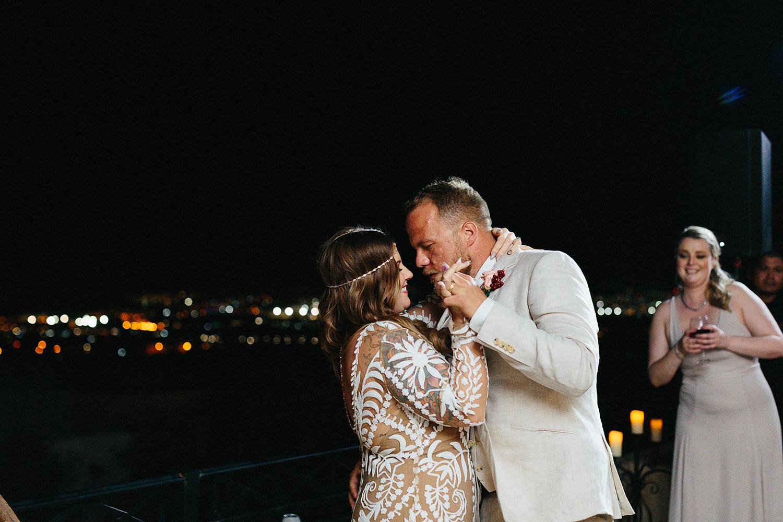 cabo-san-lucas-junebug-weddings-green-wedding-shoes-toronto-wedding-photographer-3b-photography-ventanas-private-club-mexico-reception-night-bride-and-groom-first-dance-real-moments.jpg