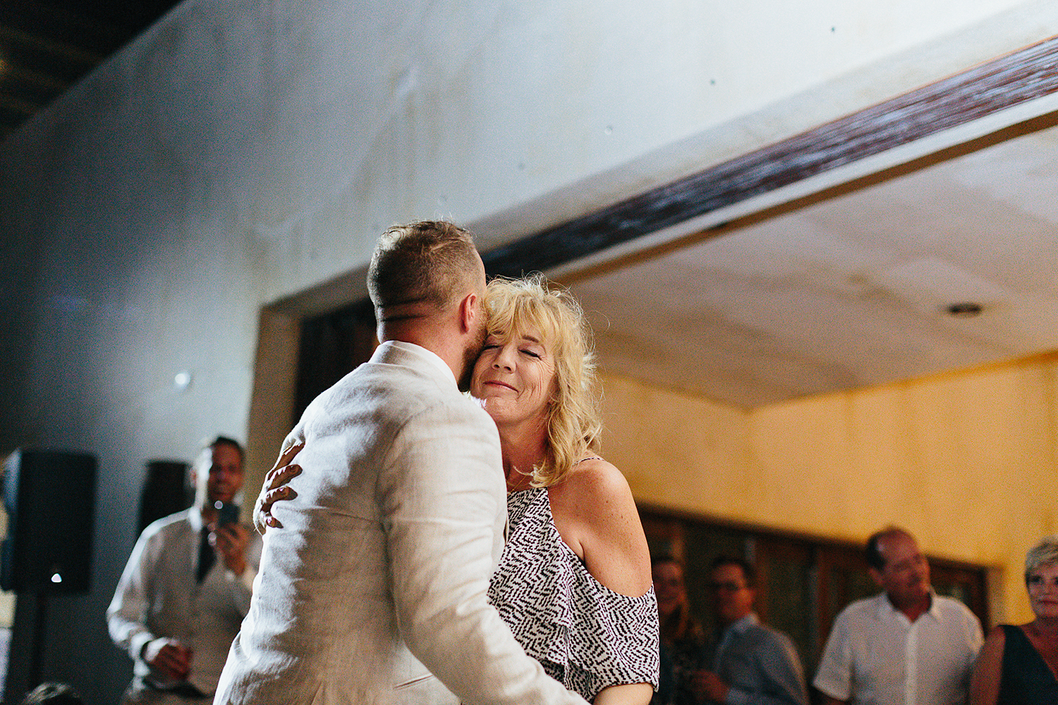 cabo-san-lucas-junebug-weddings-green-wedding-shoes-toronto-wedding-photographer-3b-photography-ventanas-private-club-mexico-reception-night-mother-and-son-first-dance-real-moments.jpg