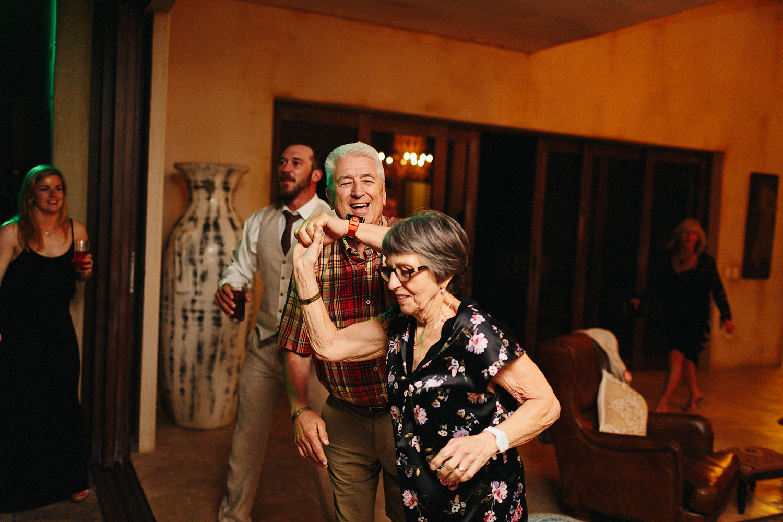 cabo-san-lucas-junebug-weddings-green-wedding-shoes-toronto-wedding-photographer-3b-photography-ventanas-private-club-mexico-reception-night-real-moments-party-dancing-good-times-grandma-dancing.jpg