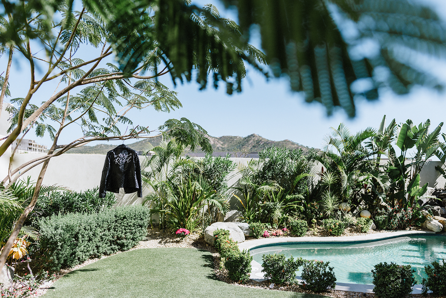 destination-wedding-cabo-san-lucas-ventanas-private-residence-alternative-toronto-wedding-photographer-details-palm-trees-getting-ready-just-married-jacket-details-leather-mrs-jacket-mountains.jpg