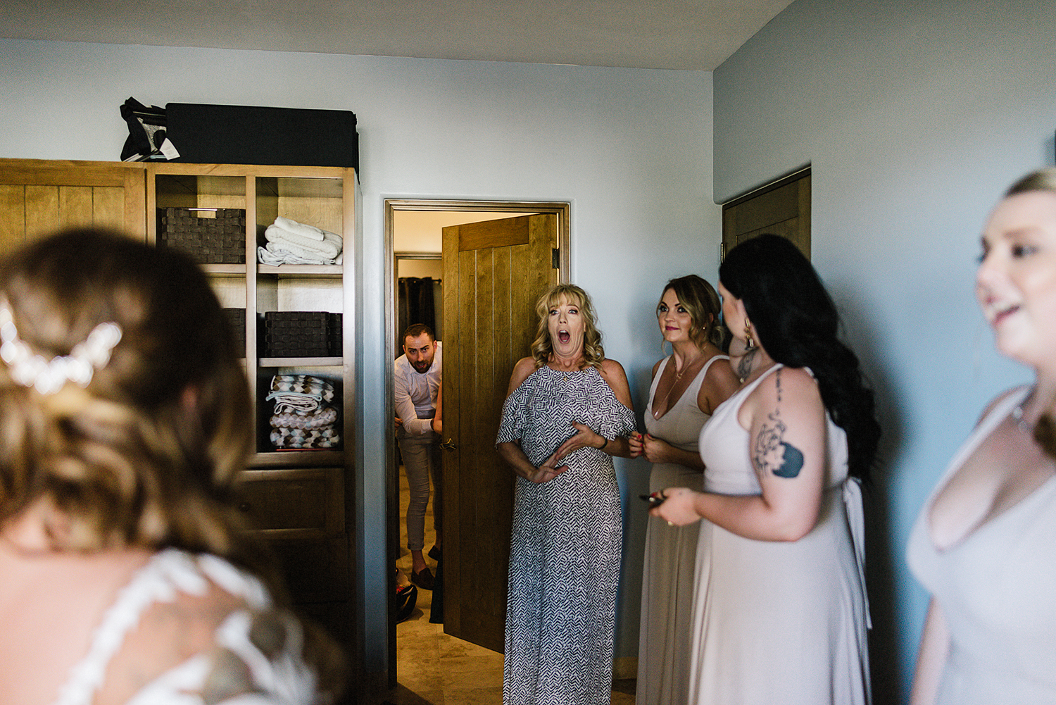 destination-wedding-cabo-san-lucas-ventanas-private-residence-alternative-toronto-wedding-photographer-bride-getting-ready-tattooed-bride-dressing-with-help-from-bridesmaids-candid-moments-artistic-documentary-mom-first-look.jpg