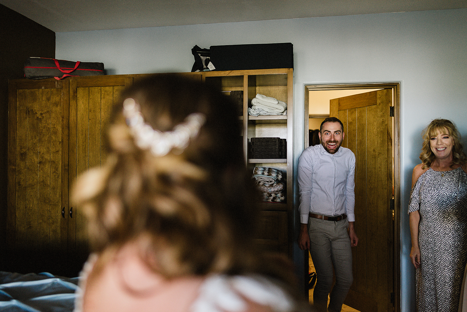destination-wedding-cabo-san-lucas-ventanas-private-residence-alternative-toronto-wedding-photographer-bride-getting-ready-tattooed-bride-dressing-with-help-from-bridesmaids-candid-moments-artistic-documentary-best-friend-first-look.jpg