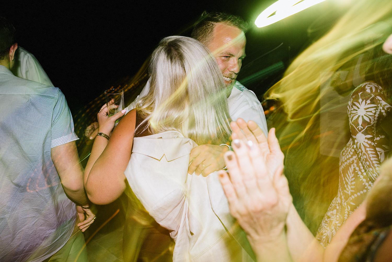 cabo-san-lucas-ventanas-private-residence-alternative-toronto-wedding-photographer-documentary-photojournalistic-reception-party-dancing-photos-candid-documentary-moments-groom-hugging-friend.jpg