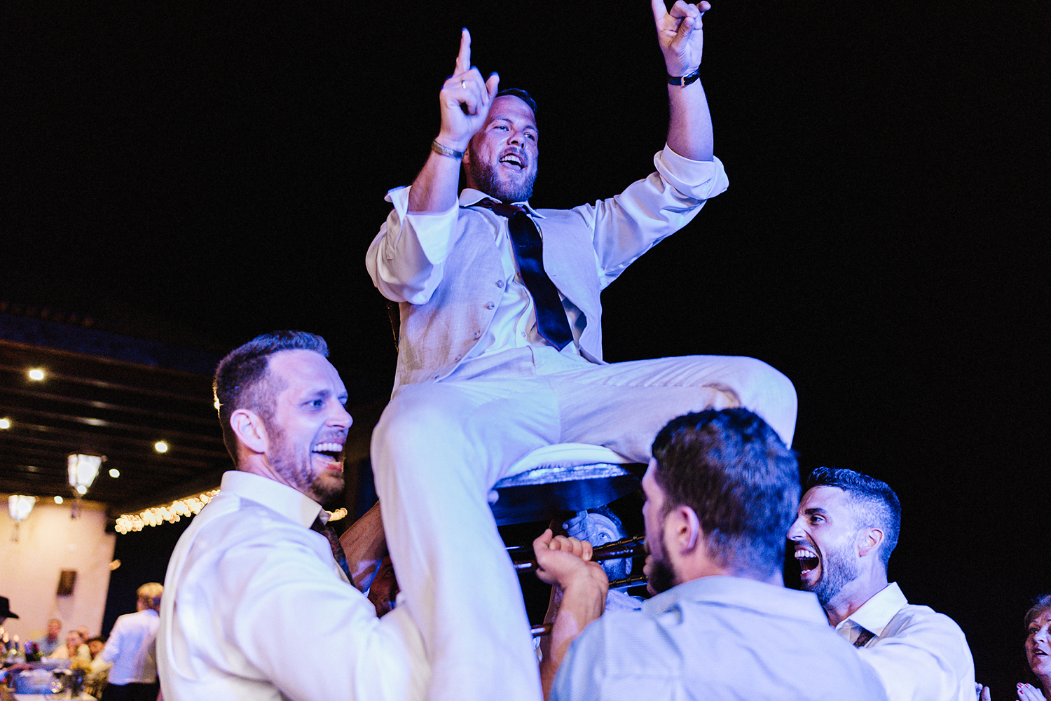 cabo-san-lucas-ventanas-private-residence-alternative-toronto-wedding-photographer-documentary-photojournalistic-reception-party-dancing-photos-candid-documentary-moments-trendy-cool-hipster-hip-hop-partying-groom-lifted-up-on-chair.jpg