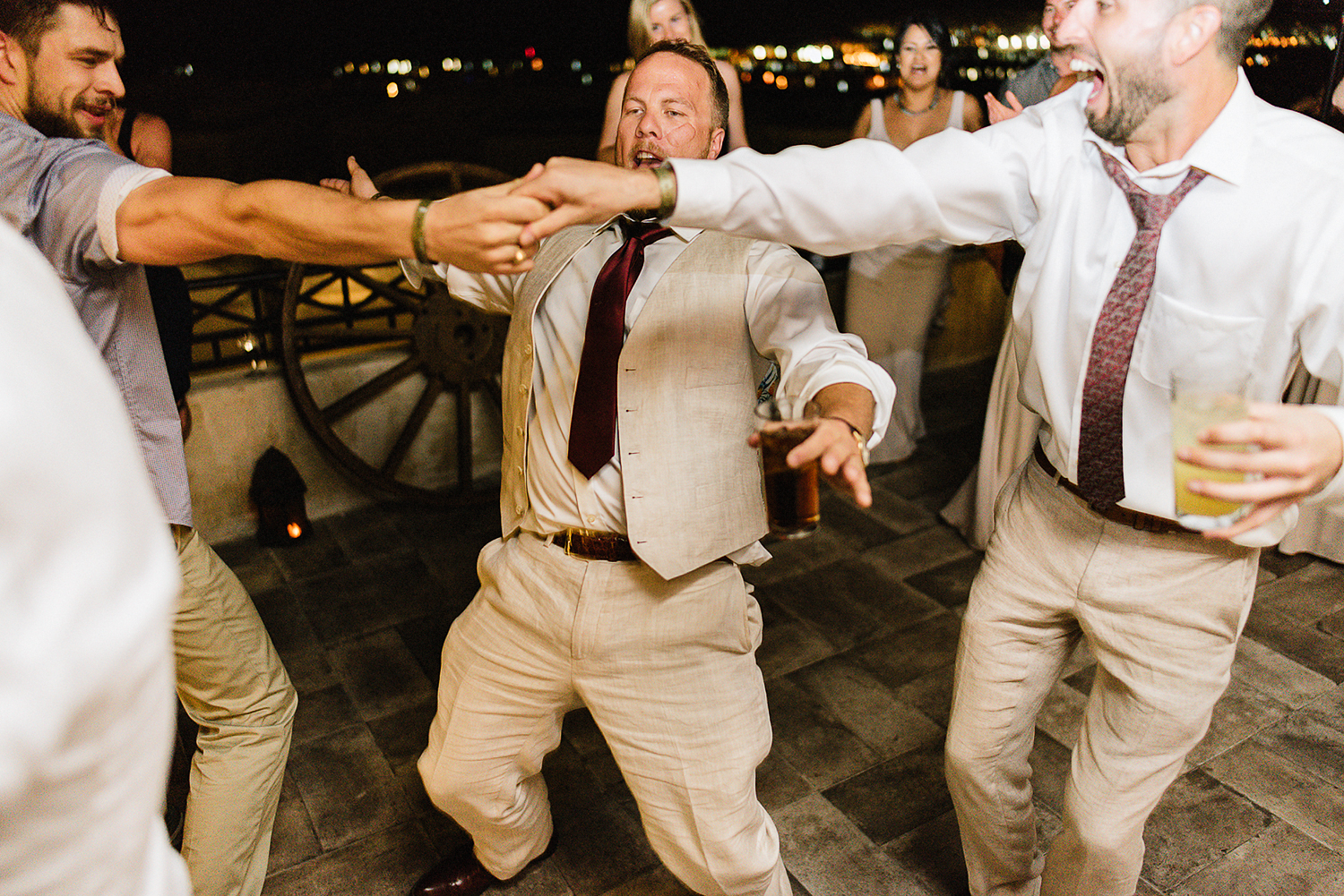 cabo-san-lucas-ventanas-private-residence-alternative-toronto-wedding-photographer-documentary-photojournalistic-reception-party-dancing-photos-candid-documentary-moments-trendy-cool-hipster-hip-hop-partying-groom-limbo.jpg