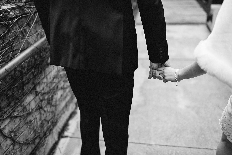 Toronto-Cloud-Gardens-Wedding-Best-Wedding-Photography-Toronto-Financial-District-Chse-Restaurent-Small-Intimate-Vintage-Wedding-Photography-Portrait-Bride-Groom-Holding-Hands.jpg