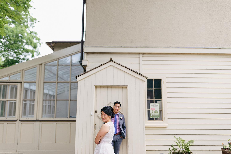 toronto-wedding-photographer-high-park-colborne-lodge-intimate-small-elopement-best-toronto-wedding-photographers-outdoor-wedding-bride-and-groom-portraits-cabin-cottage-like-vibes-historic-museum-greenhouse-modern-artistic-unique-photos.jpg