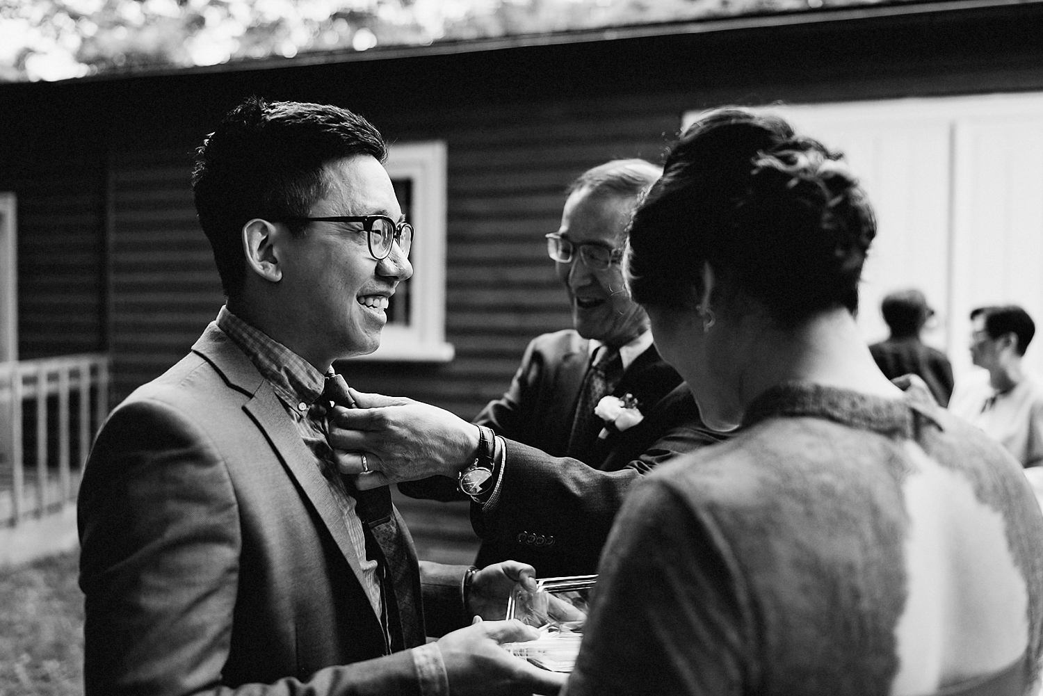 outdoor-forest-venue-toronto-high-park-colbourn-lodge-dog-friendly-venue-bride-and-groom-candid-moment-best-documentary-wedding-photographers-Toronto-Rustic-Venue-candid-guest-moment-with-Groom.jpg