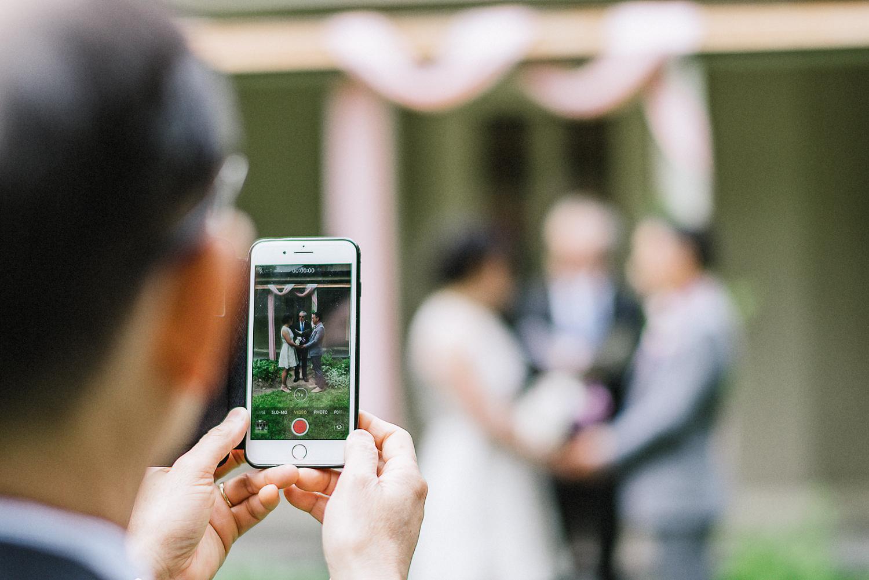 Outdoor-Wedding-Venues-Toronto-High-Park-Colbourn-Lodge-Vintage-Forest-Wedding-Bride-and-Groom-Candid-Documentary-Fine-art-wedding-photographer-Iphone-Detail-Portrait.jpg
