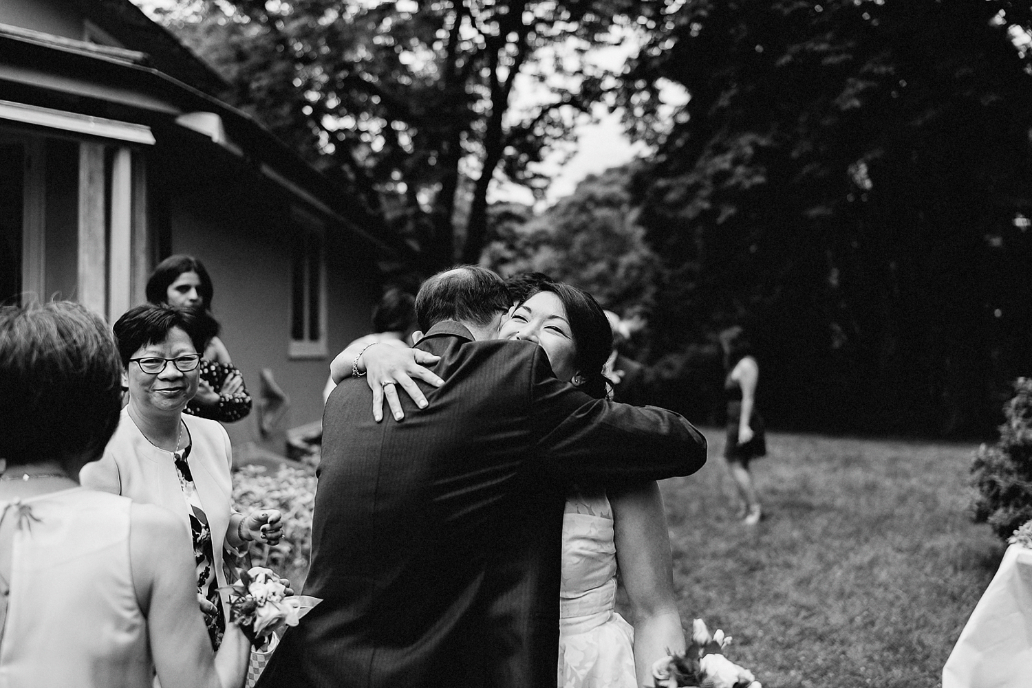 Outdoor-Forest-Ceremony-in-Toronto-Best-Wedding-Photographer-GTA-Ontario-Canada-Candid-Natural-intimate-vintage-film-analog-wedding-photography-Bride-Hugging-Father.jpg