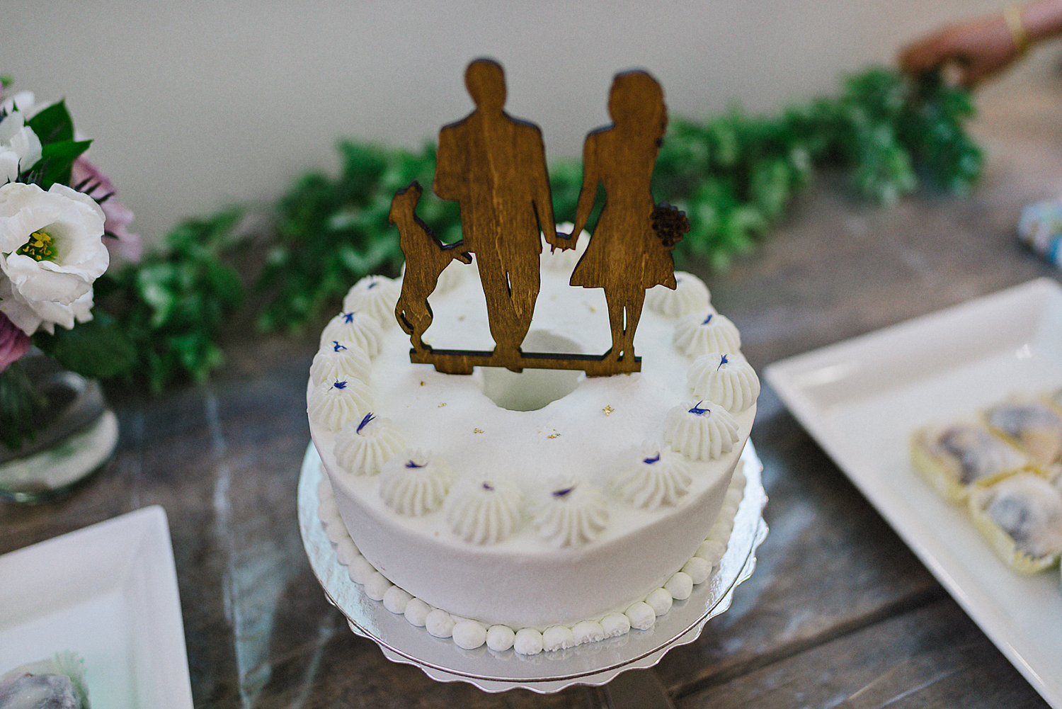 Unique-Wedding-Cake-Ideas-Toronto-Vintage-Bride-Outdoor-Forest-Wedding-Venue-High-Park-Downtown-Toronto_Candid-Editorial-Documentary-Wedding-Photographers-Dog-and-Owners-Cake-Topper.jpg