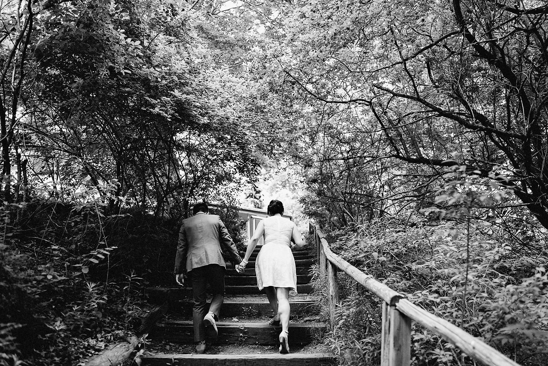 Best-Toronto-Wedding-Photographers_High-Park-Wedding_The-Lodge-Wedding_George-Restaurant-Reception_Analog-Film_Intimate-Casual-Outdoor-Forest-Wedding-High-Park-Toronto-Candid-Couple-Portrait-Walking-through-forest.jpg