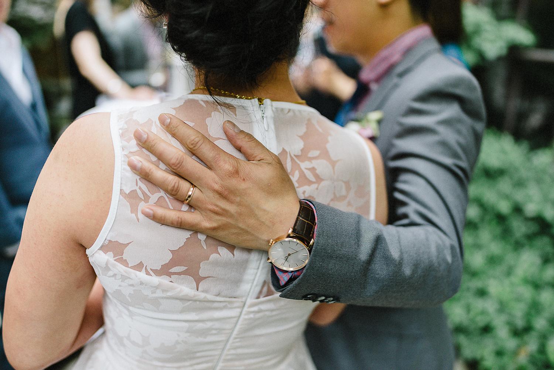 Best-Toronto-Wedding-Photographers_High-Park-Wedding_The-Lodge-Wedding_George-Restaurant-Reception_Analog-Film_Intimate-Candid-Photography_Guests-Detail_Outdoor-Summer-Wedding-Toronto_Restaurant-Bride-and-Groom-Candid_Groom-Gentle-Touch.jpg