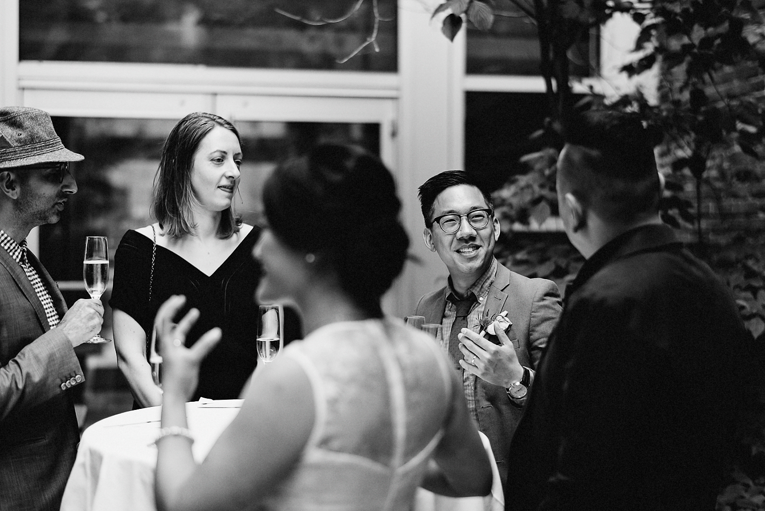 Best-Toronto-Wedding-Photographers_High-Park-Wedding_The-Lodge-Wedding_George-Restaurant-Reception_Analog-Film_Intimate-Candid-Photography_Guests-Detail_Outdoor-Summer-Wedding-Toronto_Casual-Restaurant-Wedding-candid-Groom-Conversation.jpg