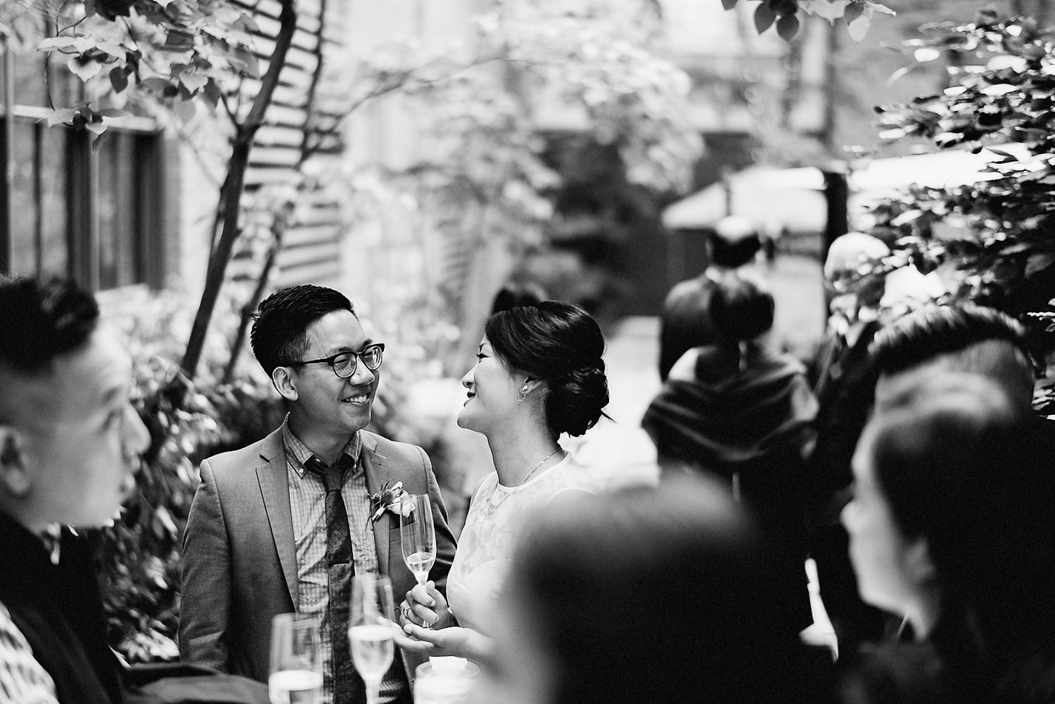 Best-Toronto-Wedding-Photographers_High-Park-Wedding_The-Lodge-Wedding_George-Restaurant-Reception_Analog-Film_Intimate-Candid-Photography_Guests-Detail_Outdoor-Summer-Wedding-Toronto_Casual-Restaurant-Wedding-Groom-and-Bride-Candid-Moment.jpg