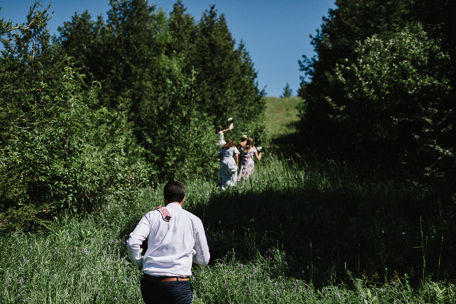 Outdoor-CeremonyIdeas-Bride-and-Groom-Exit-Toronto-Vintage-Bride-Outdoor-Forest-Wedding-Venue-High-Park-Downtown-Toronto_Candid-Editorial-Documentary-Wedding-Photographers-Sweet-Candid-Moment-Between-Groom--and-Bride-hugging-guests.jpg