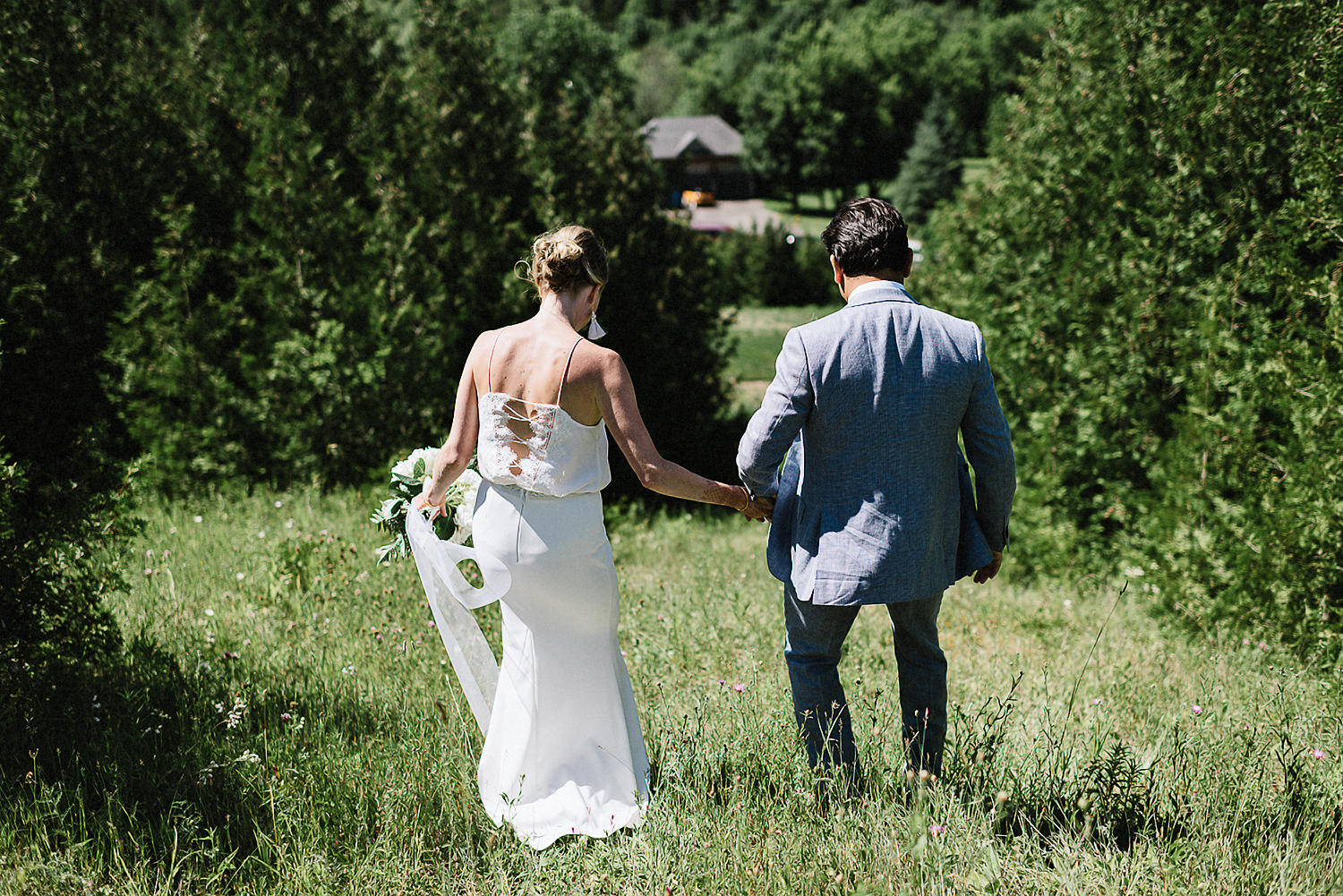 Outdoor-CeremonyIdeas-Bride-and-Groom-Exit-Toronto-Vintage-Bride-Outdoor-Forest-Wedding-Venue-High-Park-Downtown-Toronto_Candid-Editorial-Documentary-Wedding-Photographers-Sweet-Candid-Moment-Between-Groom--and-Bride-Shoes-Details.jpg