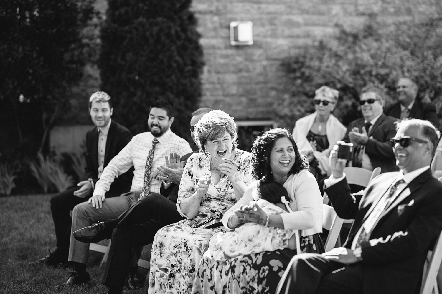 Best-Documentary-photojournalistic-wedding-photographers-Toronto-Ontario-Canada-Rural-Country-House-Backyard-Wedding-Ceremony-Vintage-aesthetic-bride-and-groom-just-married-baby-surprise-news-parents-laughing-at-grandparents-reaction.jpg