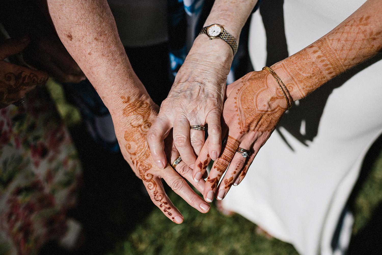 Best-Documentary-photojournalistic-wedding-photographers-Toronto-Ontario-Canada-Rural-Country-House-Backyard-Wedding-Ceremony-Vintage-Couple-Aesthetic-Brides-family-generational-hands-wedding-rings-details.jpg