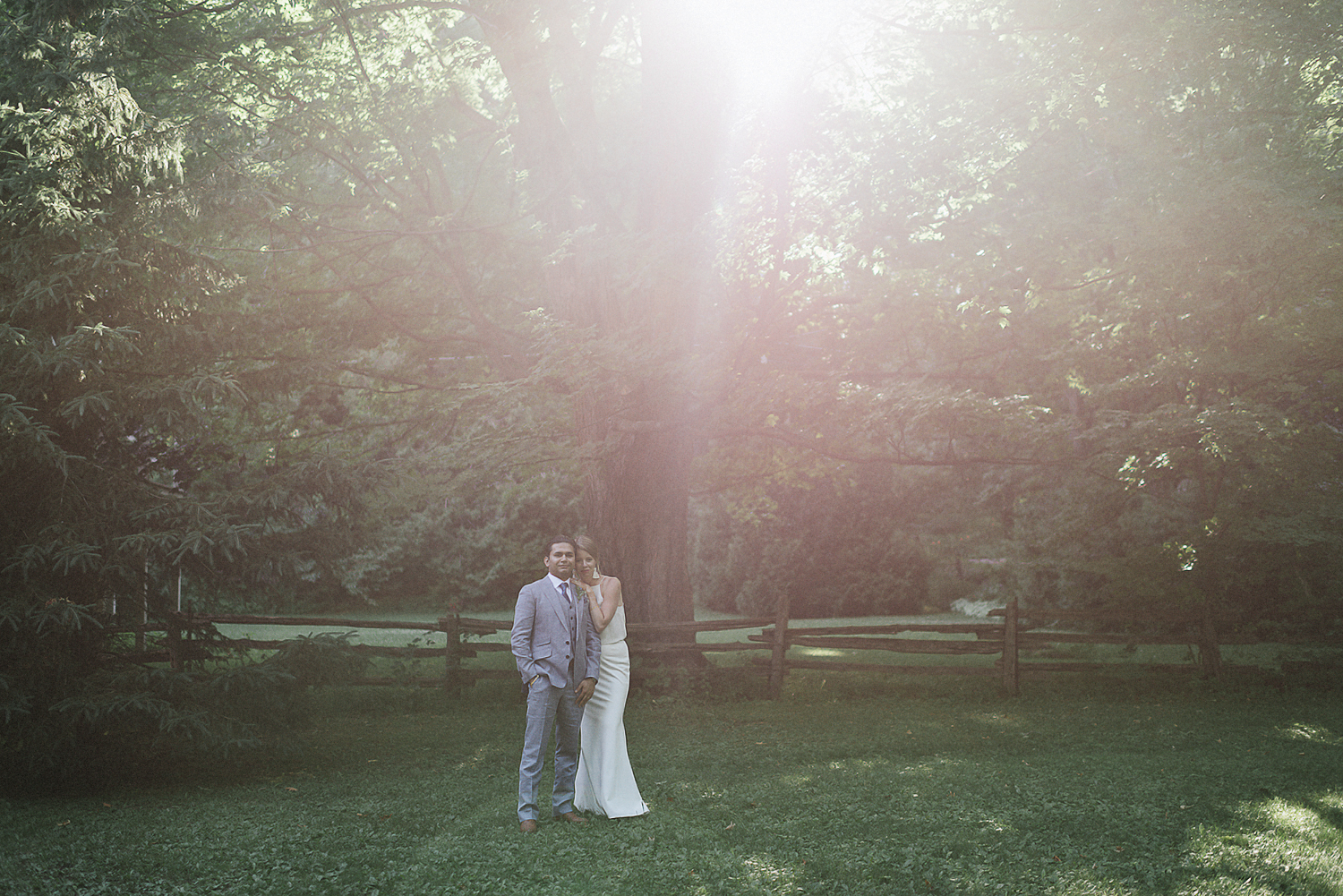 Fine-Art-Documentary-Wedding-Photographer-Toronto-Ontario-Canada_-High-Park-The-Lodge-Outdoor-Forest-Wedding_-Candid-moment-between-bride-and-groom--Lost-in-Forest-Trees-Epic-Candid-Moment-candid-portrait-among-forest-trees-Alternative.jpg