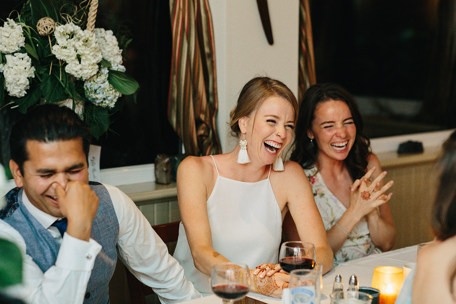 Country-Side-Wedding-Reception-at-private-Inn-restaurant-Vintage-speeches-bride-and-sister-having-a-moment-laughing-so-hard.jpg