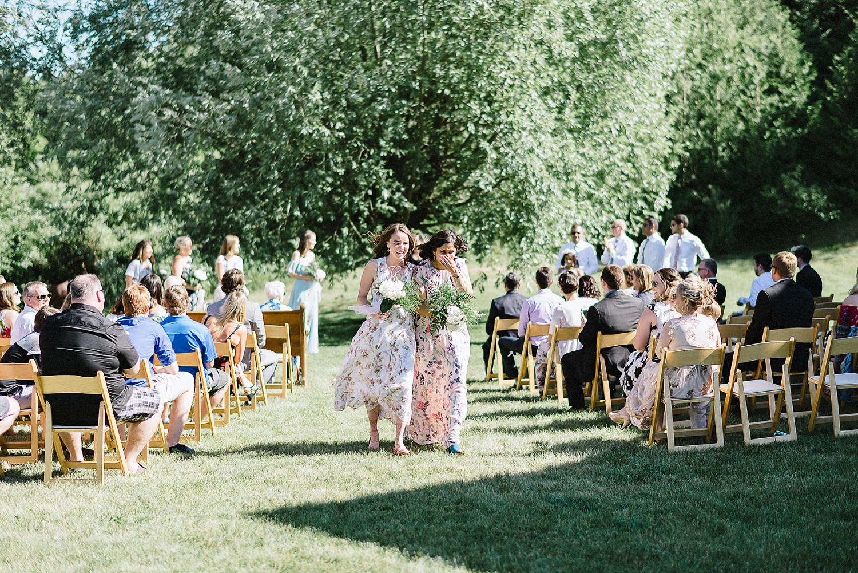 Best-Documentary-photojournalistic-wedding-photographers-Toronto-Ontario-Canada-Rural-Country-House-Backyard-Wedding-Ceremony-Vintage-Couple-Aesthetic-Bridesmaids-walking-down-aisle.jpg