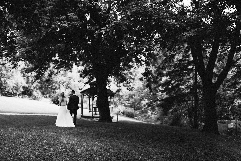 Bride-and-Groom-Boho-Aesthetic-Toronto-Wedding-Photography-Summer-Vintage-Wedding-Groom-and-Bride-walking-through-trees-artistic.jpg