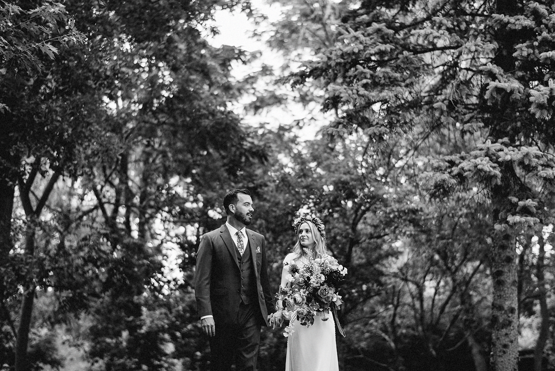 Bride-and-Groom-Boho-Aesthetic-Toronto-Wedding-Photography-Summer-Vintage-Wedding-Groom-and-Bride-walking-through-trees.jpg