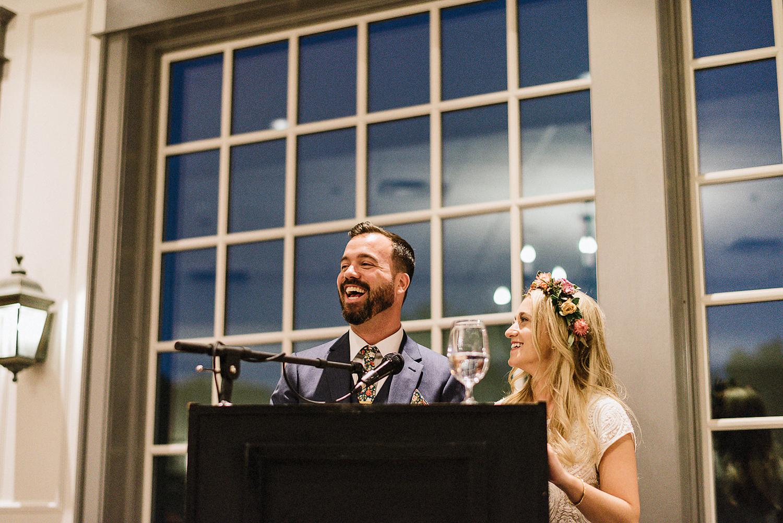 Best-Wedding-Venues-Toronto-Vintage-Country-Home-Doctors-House-Kleinburg-Analog-Film-Wedding-Photography-Best-Wedding-photographers-Toronto-3B-Photo-Bride-and-Groom-Speech-Candid-Laugh.jpg