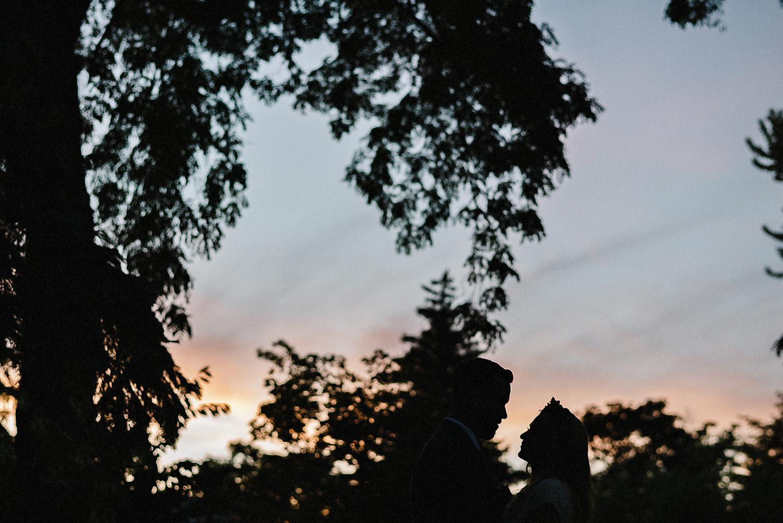 Best-Wedding-Venues-Toronto-Vintage-Country-Home-Doctors-House-Kleinburg-Analog-Film-Wedding-Photography-Best-Wedding-photographers-Toronto-3B-Photo-Bride-and-Groom-watching-Pink-Sunset-tree-details.jpg