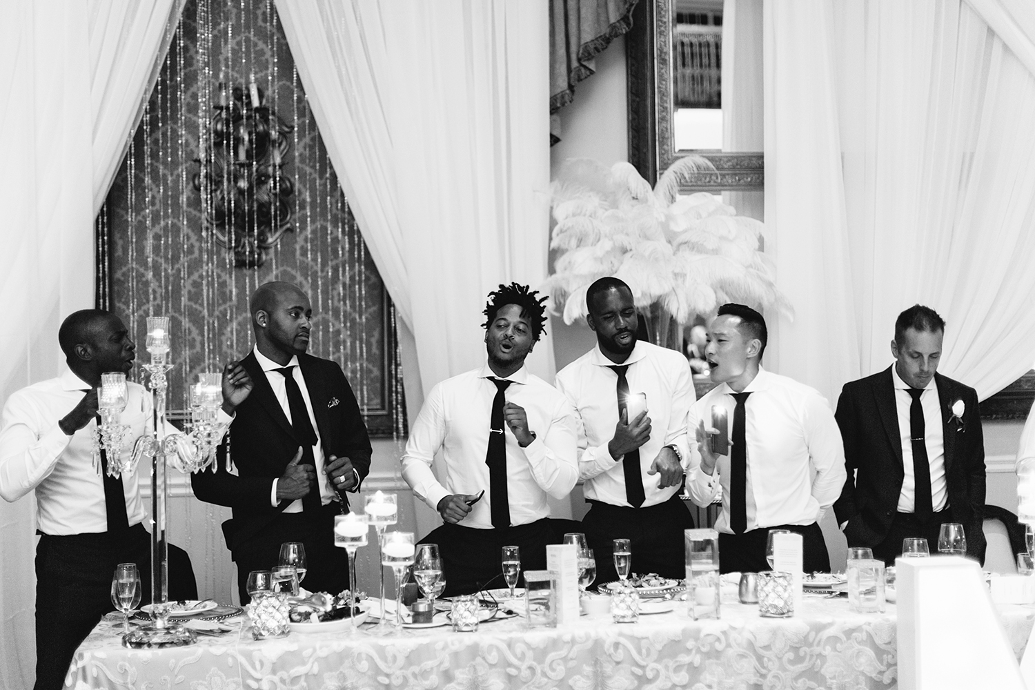 Best-Wedding-Venues-Toronto-Liberty-Grande-vintage-wedding-photography-toronto-bride-and-groom-wedding-photographer-reception-mother-son-dance-emotional-mom-groomsmen-singing-along-bw.jpg