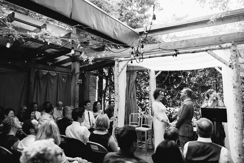 urban-downtown-toronto-wedding-fat-pasha-torontos-best-wedding-photographer-3b-photography-film-photographer-analog-photography-ceremony-on-outdoor-patio-kodak-portra-800-bride-and-groom-vows-emotional-love-bw.jpg