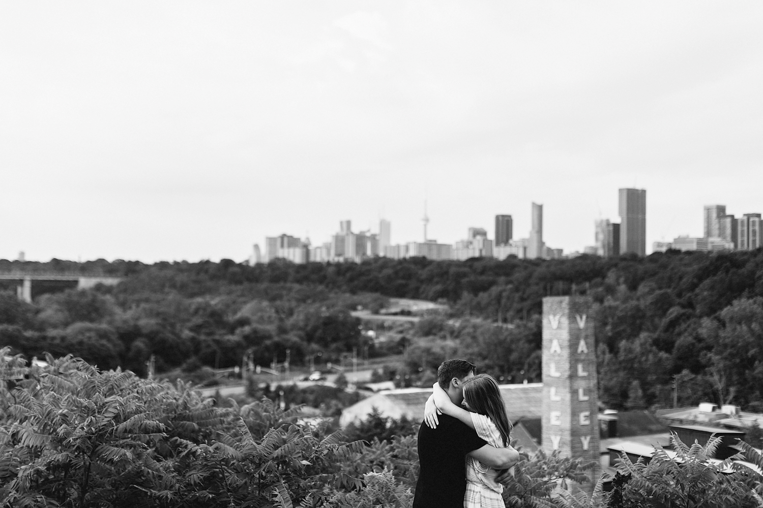 Toronto-Evergreen-Brickworks-Engagement-Photography-best-toronto-wedding-photographers-3b-photography-documentary-photojournalistic-film-analog-photography-couples-portraits-engaged-candid-romantic-artistic-creative-skyline-bw.jpg