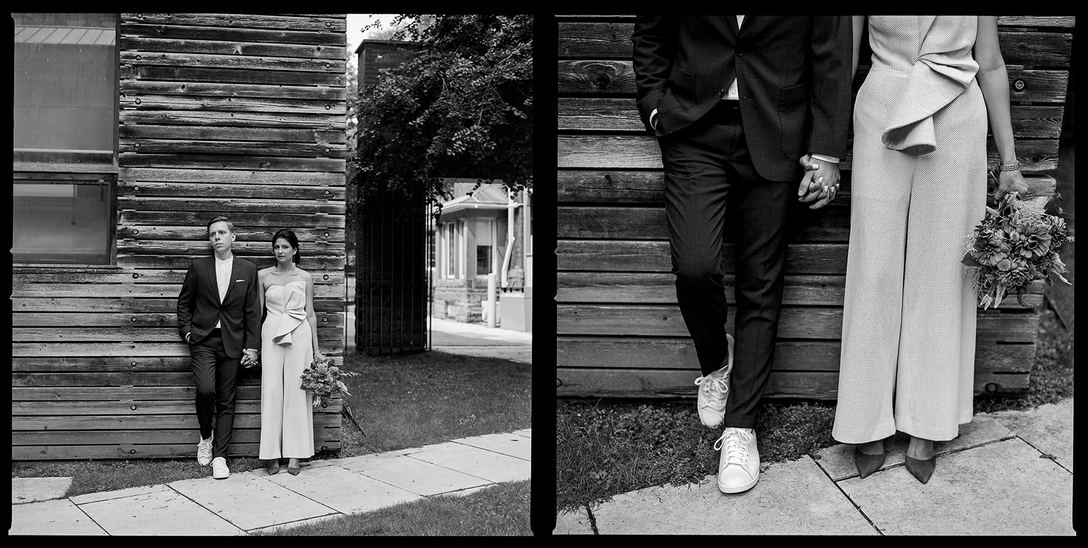 1-Bride-and-Groom-wearing-Sneakers-and-blue-heels-for-wedding-analog-wedding-photographers-toronto-ontario-canada-vintage-vibes-trendy-modern-downtown-toronto-restaurant-wedding-candid-portrait-quiet-moment-black-and-white-film-photography.jpg