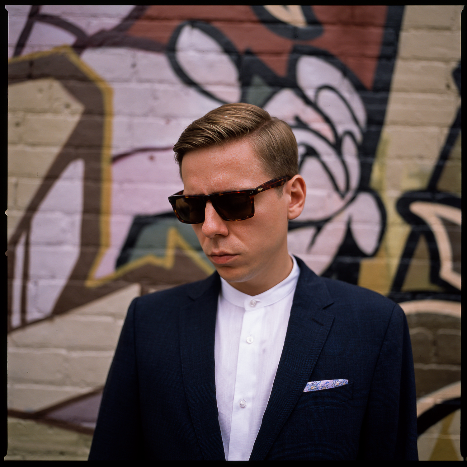 trendy-loversland-Groom-wearing-slim-fitted-suit-with-no-tie-kensington-Market-Bridal-portraits-Analog-Film-Best-Wedding-Photographers-Toronto.jpg