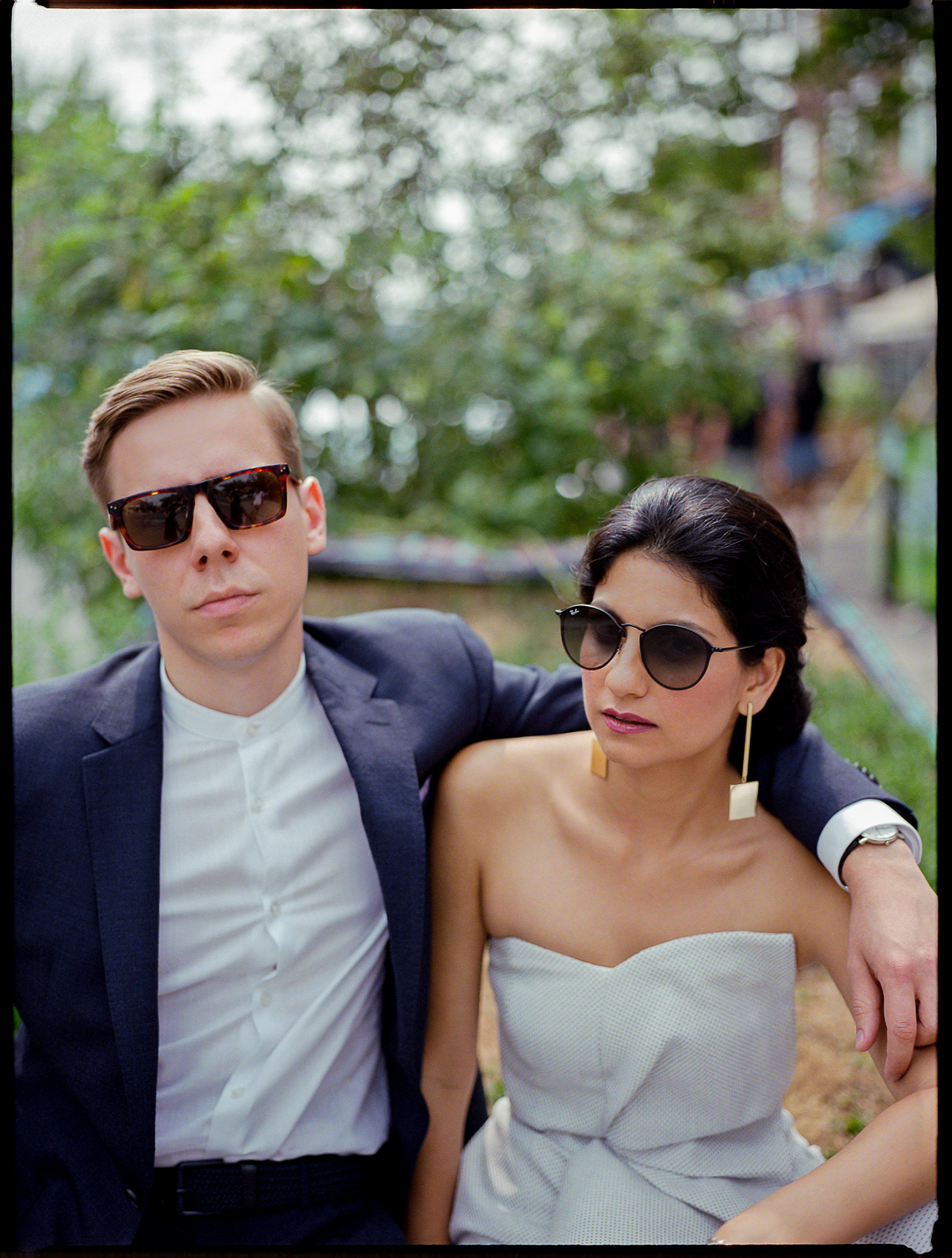 Best-Documentary-Wedding-Photographers-Toronto-Analog-Film-Photographer-Downtown-Kensington-Market-City-Bride-Bridal-Jumpsuit-Style-Inspiration-Graffiti-Vibes-Cool-Bride-and-Groom.jpg