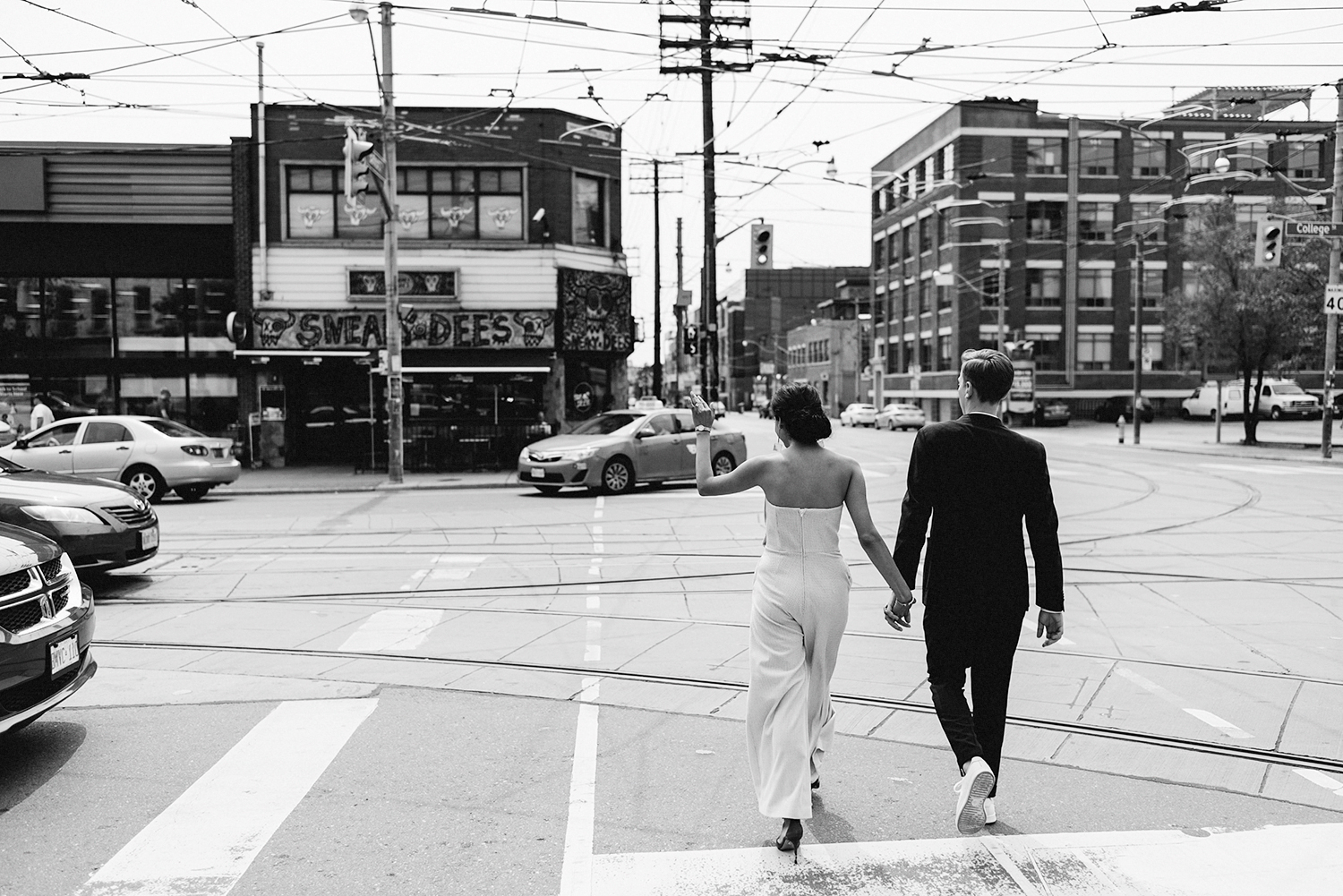 Intimate-Toronto-Pop-Up-Elopement-Downtown-Urban-film-analog-photography-toronto-wedding-photographers-alternative-hipster-bride-and-groom-badass-graffiti-cool-brides-jumpsuit-loversland-sneaky-dees-bar-photojournalistic-bw.jpg