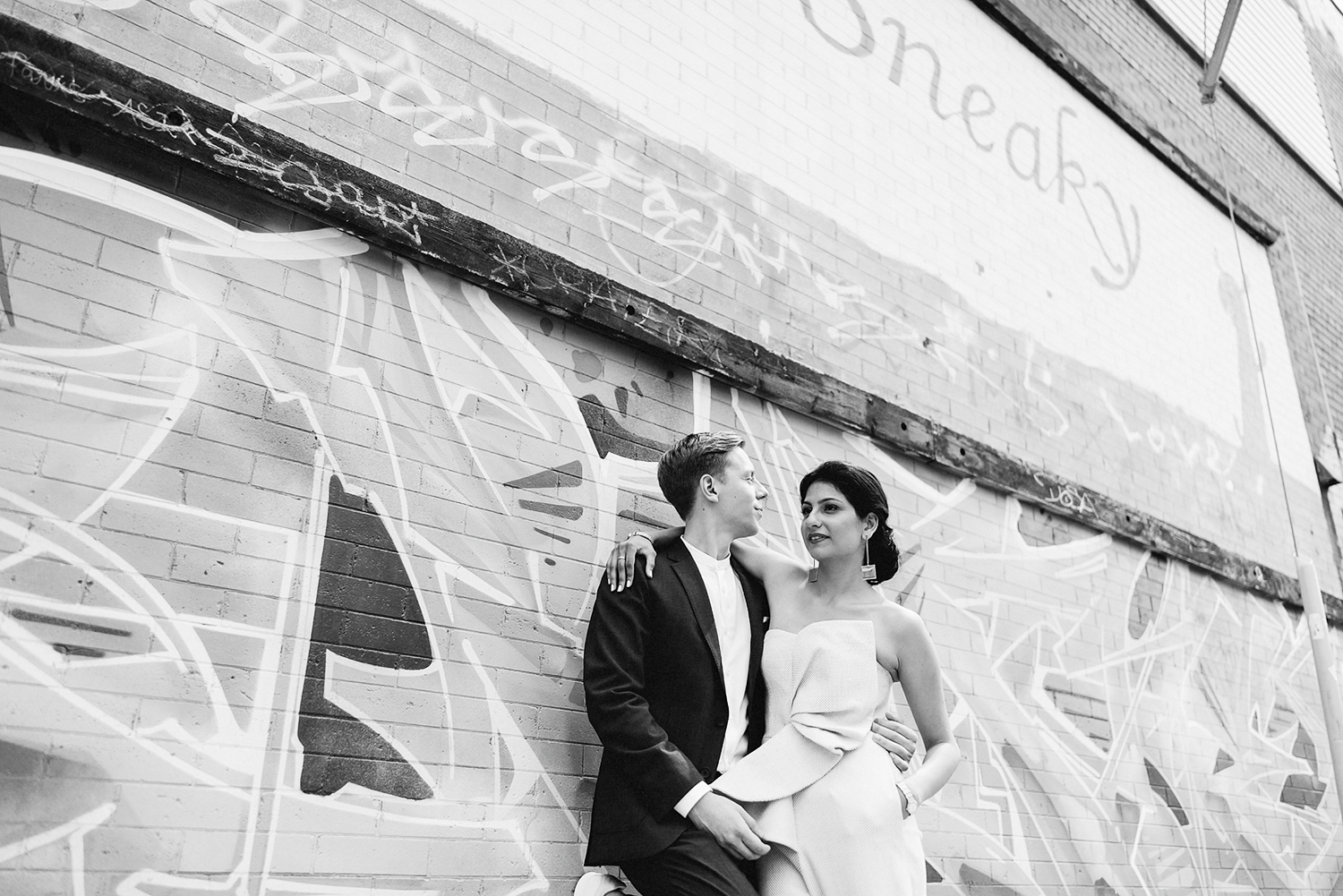 _Pop-Up-Elopement-Downtown-Urban-film-analog-photography-toronto-wedding-photographers-alternative-hipster-bride-and-groom-badass-graffiti-cool-brides-jumpsuit-loversland-sneaky-dees-bar-photojournalistic-magazine-brick-walls-bw.jpg
