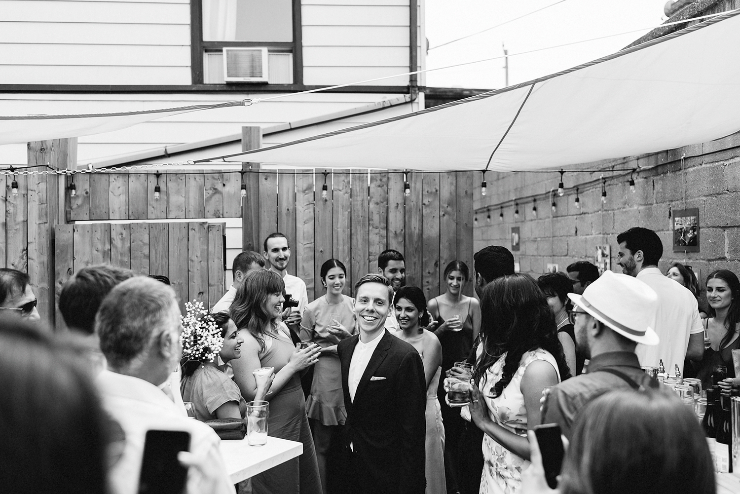 film-analog-photography-toronto-film-wedding-photographers-alternative-reception-bar-pray-tell-cocktail-hour-reception-casual-bride-and-groom-entrance.jpg