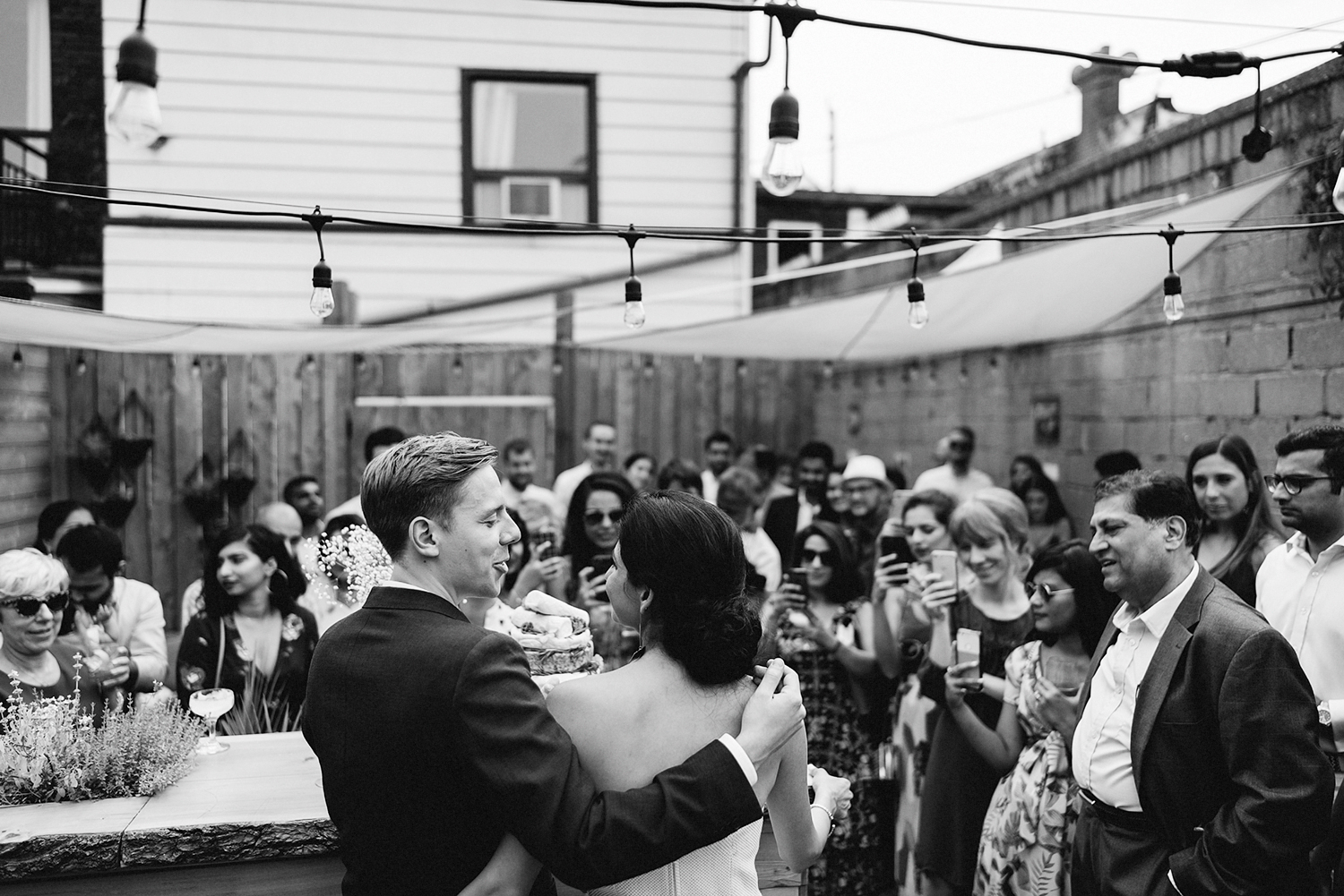 urban-downtown-toronto-wedding-fat-pasha-torontos-best-wedding-photographer-3b-photography-film-photographer-analog-photography-ceremony-on-outdoor-patio-kodak-portra-800-bride-and-groom-vows-emotional-crying-bw.jpg