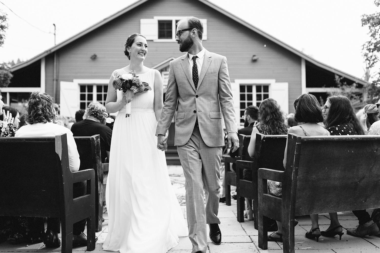 Toronto-Island-Wedding-Toronto-Best-Film-Wedding-Photographers-3b-photography-analog-photography-wards-island-clubhouse-junebug-weddings-vintage-venue-reception-candid-documentary-bride-and-groom-just-married-recessional-smiling-bw.jpg